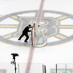 A rink worker moves the net toward its position on the ice before Game 3 of the NHL hockey Stanley Cup Finals  between the Boston Bruins and Chicago Blackhawks in Boston, Monday, June 17, 20 …