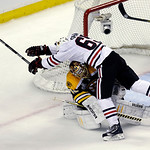 Chicago Blackhawks center Andrew Shaw (65) collides with Boston Bruins goalie Tuukka Rask, underneath, of Finland,during the first period in Game 3 of the NHL hockey Stanley Cup Finals in Bo …