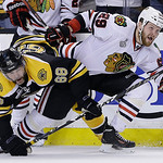 Boston Bruins right wing Jaromir Jagr (68), of the Czech Republic, ties up Chicago Blackhawks left wing Bryan Bickell (29) during the third period in Game 3 of the NHL hockey Stanley Cup Fin …