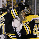 Boston Bruins center Patrice Bergeron (37) congratulates Boston Bruins goalie Tuukka Rask (40), of Finland, on his shutout to beat the Chicago Blackhawks 2-0 in Game 3 of the NHL hockey Stan …