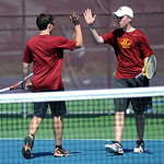 Avon Lake's Austin Goetz and James Moore high-five after scoring a point against Avon.