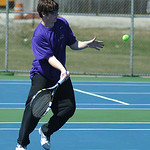 Avon's William Alexander returns a ball toward Avon Lake during their second doubles championship round.