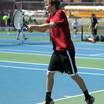 Avon Lake's Ryan Stonecipher returns a ball toward Avon during their third singles, first-place match.
