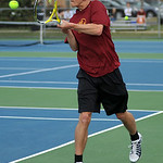 Avon Lake's James Darkow plays first singles against Westlake's Cal Craven.