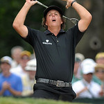 Phil Mickelson reacts as his ball hit from a bunker narrowly misses the hole on an eagle-attempt during the final day of the U.S. Open golf tournament on Sunday, June 16, 2013, at Merion Gol …