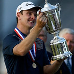 Justin Rose, of England, celebrates with the trophy after winning the U.S. Open golf tournament at Merion Golf Club, Sunday, June 16, 2013, in Ardmore, Pa. (AP Photo/Julio Cortez)
