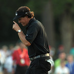 Phil Mickelson tips his hat to fans as he makes his way up the 18th fairway during the final day of the U.S. Open Sunday, June 16, 2013 at the Merion Golf Club in Ardmore, Pa. (AP Photo/The  …
