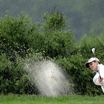 Justin Rose, of England, hits out of a bunker on the 14th hole during the fourth round of the U.S. Open golf tournament at Merion Golf Club, Sunday, June 16, 2013, in Ardmore, Pa. (AP Photo/ …