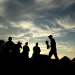 Justin Rose, of England, walks on the 18th green with the trophy after winning the U.S. Open golf tournament at Merion Golf Club, Sunday, June 16, 2013, in Ardmore, Pa. (AP Photo/Charlie Rie …