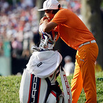 Rickie Fowler waits for his caddie to walk off the 18th green during the fourth round of the U.S. Open golf tournament at Merion Golf Club, Sunday, June 16, 2013, in Ardmore, Pa. (AP Photo/M …