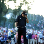 Phil Mickelson reacts after missing a shot on the 18th hole during the fourth round of the U.S. Open golf tournament at Merion Golf Club, Sunday, June 16, 2013, in Ardmore, Pa. (AP Photo/Mor …
