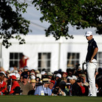 Justin Rose, of England, checks his lie on the 18th hole during the fourth round of the U.S. Open golf tournament at Merion Golf Club, Sunday, June 16, 2013, in Ardmore, Pa. (AP Photo/Julio  …