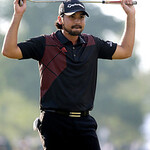 Jason Day, of Australia, reacts after a putt on the 18th hole during the fourth round of the U.S. Open golf tournament at Merion Golf Club, Sunday, June 16, 2013, in Ardmore, Pa. (AP Photo/M …