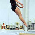 Avon's Whitney Stoops, two -time defending state vault champion, at Great Lake Gymnastics in Avon Lake Dec. 6.   Steve Manehim