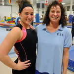 Avon's Whitney Stoops, two -time defending state vault champion,  with mother Janet,  at Great Lake Gymnastics in Avon Lake Dec. 6.   Steve Manehim