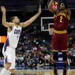 Cleveland Cavaliers' Kyrie Irving (2) shoots over Charlotte Bobcats' Jeffery Taylor (44) during the second half of an NBA basketball game in Charlotte, N.C., Wednesday, April 17, 2013. The B …