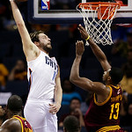 Charlotte Bobcats' Josh McRoberts, left, goes up to dunk against Cleveland Cavaliers' Tristan Thompson, right, during the second half of an NBA basketball game in Charlotte, N.C., Wednesday, …