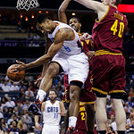 Charlotte Bobcats' Gerald Henderson (9) passes the ball as he is trapped by Cleveland Cavaliers' Tyler Zeller (40) and Tristan Thompson during the first half of an NBA basketball game in Cha …