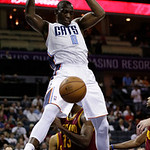 Charlotte Bobcats' Bismack Biyombo (0) dunks against the Cleveland Cavaliers during the first half of an NBA basketball game in Charlotte, N.C., Wednesday, April 17, 2013. (AP Photo/Chuck Bu …