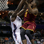 Cleveland Cavaliers' Dion Waiters (3) drives against Charlotte Bobcats' Bismack Biyombo (0) during the second half of an NBA basketball game in Charlotte, N.C., Wednesday, April 17, 2013. Th …