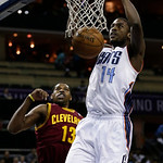 Charlotte Bobcats' Michael Kidd-Gilchrist (14) dunks past Cleveland Cavaliers' Tristan Thompson (13) during the first half of an NBA basketball game in Charlotte, N.C., Wednesday, April 17,  …