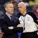 Charlotte Bobcats head coach Mike Dunlap, left, talks with referee Dick Bavetta, right, during the first half of an NBA basketball game against the Cleveland Cavaliers in Charlotte, N.C., We …