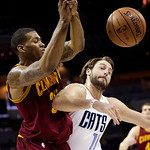 Charlotte Bobcats' Josh McRoberts, right, knocks the ball from Cleveland Cavaliers' Alonzo Gee, left, during the second half of an NBA basketball game in Charlotte, N.C., Wednesday, April 17 …