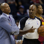 Cleveland Cavaliers head coach Byron Scott, left, talks with referee Haywoode Workman, right, during the first half of an NBA basketball game against the Charlotte Bobcats in Charlotte, N.C. …