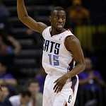 Charlotte Bobcats' Kemba Walker (15) reacts after making a basket against the Cleveland Cavaliers during the second half of an NBA basketball game in Charlotte, N.C., Wednesday, April 17, 20 …