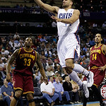 Charlotte Bobcats' Jeffery Taylor, right, drives to the basket against Cleveland Cavaliers' Alonzo Gee, left, during the first half of an NBA basketball game in Charlotte, N.C., Wednesday, A …