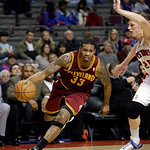 Cleveland Cavaliers forward Alonzo Gee (33) drives on Detroit Pistons forward Kyle Singler (25) in the first half of a NBA basketball game in Auburn Hills, Monday, Dec. 3, 2012. (AP Photo/Pa …
