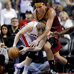 Cleveland Cavaliers center Anderson Varejao, top, of Brazil, defends Detroit Pistons forward Kyle Singler (25) during the second half of an NBA basketball game in Auburn Hills, Mich., Monday …