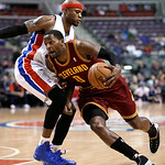 Cleveland Cavaliers forward C.J. Miles (0) drives on Detroit Pistons forward Corey Maggette (50) during the first half of an NBA basketball game in Auburn Hills, Mich., Monday, Dec. 3, 2012. …