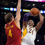 Los Angeles Lakers guard Kobe Bryant puts up a shot as Cleveland Cavaliers forward Luke Walton defends during the first half of an NBA basketball game, Sunday, Jan. 13, 2013, in Los Angeles. …
