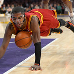 Cleveland Cavaliers guard Kyrie Irving dives for a loose ball during the second half of their NBA basketball game against the Los Angeles Lakers, Sunday, Jan. 13, 2013, in Los Angeles. The L …