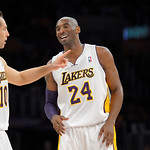 Los Angeles Lakers guard Kobe Bryant, right, jokes around with guard Steve Nash during the first half of their NBA basketball game against the Cleveland Cavaliers, Sunday, Jan. 13, 2013, in  …