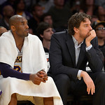 Los Angeles Lakers guard Kobe Bryant, left, watches from the bench with forward Pau Gasol, of Spain, during the first half of their NBA basketball game against the Cleveland Cavaliers, Sunda …