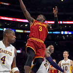 Cleveland Cavaliers guard Dion Waiters, center puts up a shot as Los Angeles Lakers forward Antawn Jamison, left, and guard Kobe Bryant defends as guard Steve Nash looks on during the second …