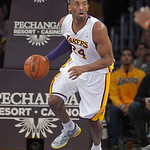 Los Angeles Lakers guard Kobe Bryant drives down court during the first half of their NBA basketball game against the Cleveland Cavaliers, Sunday, Jan. 13, 2013, in Los Angeles. (AP Photo/Ma …