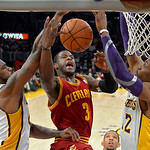 Cleveland Cavaliers guard Dion Waiters, center, goes up for a shot as Los Angeles Lakers forward Earl Clark, left, and center Dwight Howard defend during the first half of an NBA basketball  …