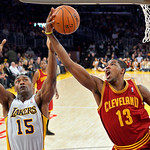 Los Angeles Lakers forward Metta World Peace, left, and Cleveland Cavaliers forward Tristan Thompson go after a rebound during the first half of an NBA basketball game, Sunday, Jan. 13, 2013 …