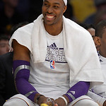Los Angeles Lakers center Dwight Howard watches from the bench during the first half of their NBA basketball game against the Cleveland Cavaliers, Sunday, Jan. 13, 2013, in Los Angeles. (AP  …