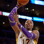 Los Angeles Lakers center Dwight Howard goes up for a shot during the first half of their NBA basketball game against the Cleveland Cavaliers, Sunday, Jan. 13, 2013, in Los Angeles. (AP Phot …