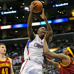 Los Angeles Clippers guard Jamal Crawford, left, drives against Cleveland Cavaliers guard C.J. Miles, right, in the second half of an NBA basketball game, Monday, Nov. 5, 2012, in Los Angele …