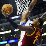 Cleveland Cavaliers guard Kyrie Irving (2) shoots a layup around Los Angeles Clippers center DeAndre Jordan, rear, in the first half of an NBA basketball game, Monday, Nov. 5, 2012, in Los A …