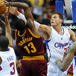 Los Angeles Clippers forward Blake Griffin (32) and guard Chris Paul (3) defend Cleveland Cavaliers forward Tristan Thompson (13) during the first half of an NBA basketball game, Monday, Nov …