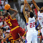 Cleveland Cavaliers guard Dion Waiters (3) shoots over Los Angeles Clippers forward Matt Barnes (22) and center Ronny Turiaf (21) for a basket in the second half of an NBA basketball game, M …