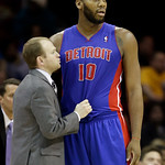 Detroit Pistons head coach Lawrence Frank, left, talks to Greg Monroe (10) in the second quarter of an NBA basketball game against the Cleveland Cavaliers, Wednesday, April 10, 2013, in Clev …
