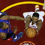 Cleveland Cavaliers' Tristan Thompson, right, shoots inside Detroit Pistons' Greg Monroe (10) in the first half of an NBA basketball game on Wednesday, April 10, 2013, in Cleveland. (AP Phot …