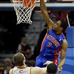 Detroit Pistons' Brandon Knight (7) dunks over Cleveland Cavaliers' Tyler Zeller (40) and Tristan Thompson (13) in the second quarter of an NBA basketball game on Wednesday, April 10, 2013,  …